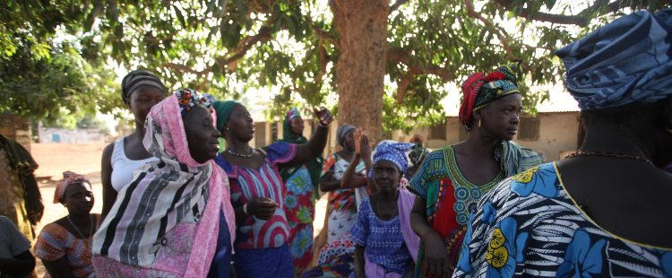 Group of women in The Gambia dressed in bright, traditional African clothing