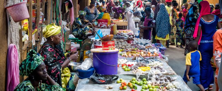 busy market stalls in the gambia