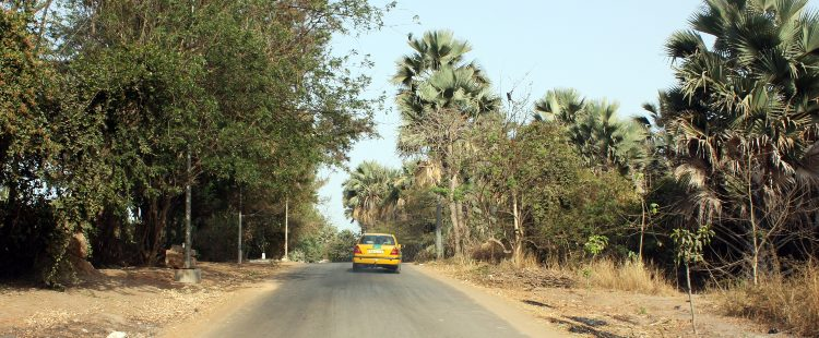 yellow car on road in bijilo, gambia